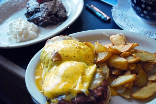 Eggs Benedict layered over giant crab cakes