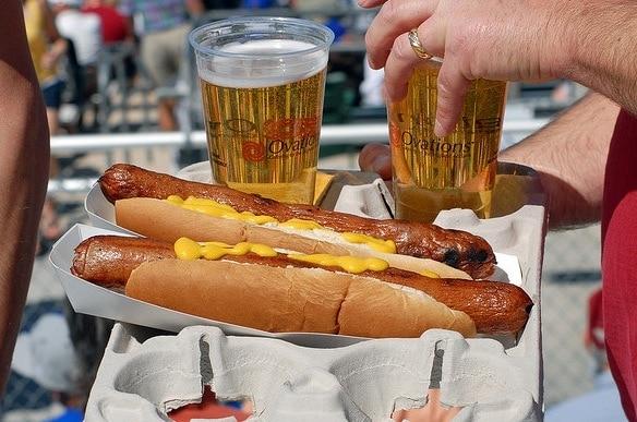 hot dog and beer at baseball game