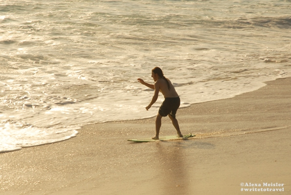 Skim boarding at Tamarack Beach in Carlsbad, California