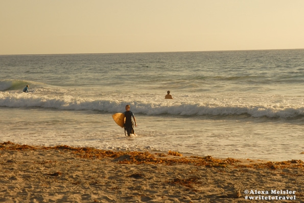 Surfer at Tamarack Beach in Carlsbad, California