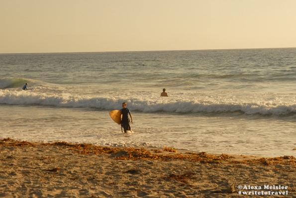 Surfer at Tamarack Beach in Carlsbad, California