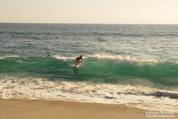 Surfer at Ponto Beach Tamarack Beach in Carlsbad, California