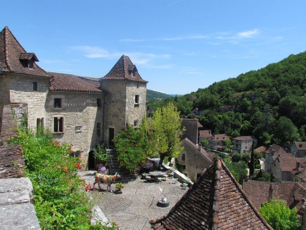 Saint Cirq LaPopie, Lot Valley, France - Saint Cirq LaPopie clings to the verdant hillside.