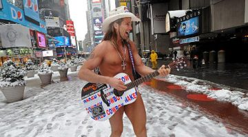 New York naked cowboy playing guitar