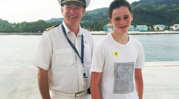 Roland with Captain David Box on Fathom Adonia Cruise