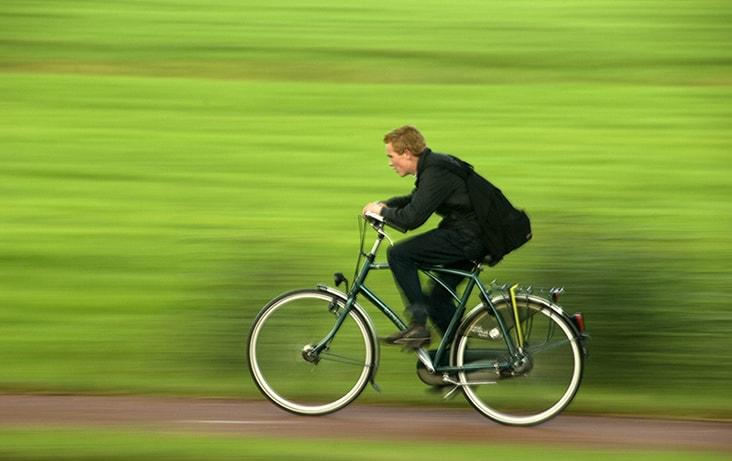 Dutch boy on bike in Woerden, Holland.