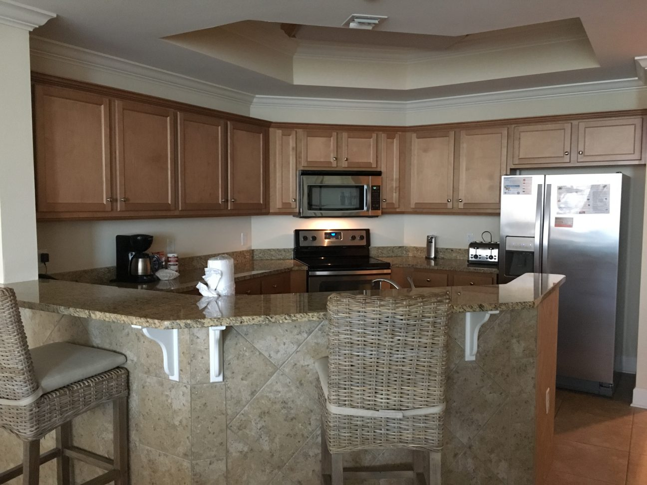 A full size kitchen as well as a wet bar is included in your stay at Phoenix West II in Gulf Shores, Alabama