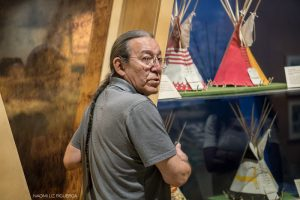 Blackfoot elder Sheldon Firstrider explains elements of indigenous culture at the Glenbow Museum in Calgary.