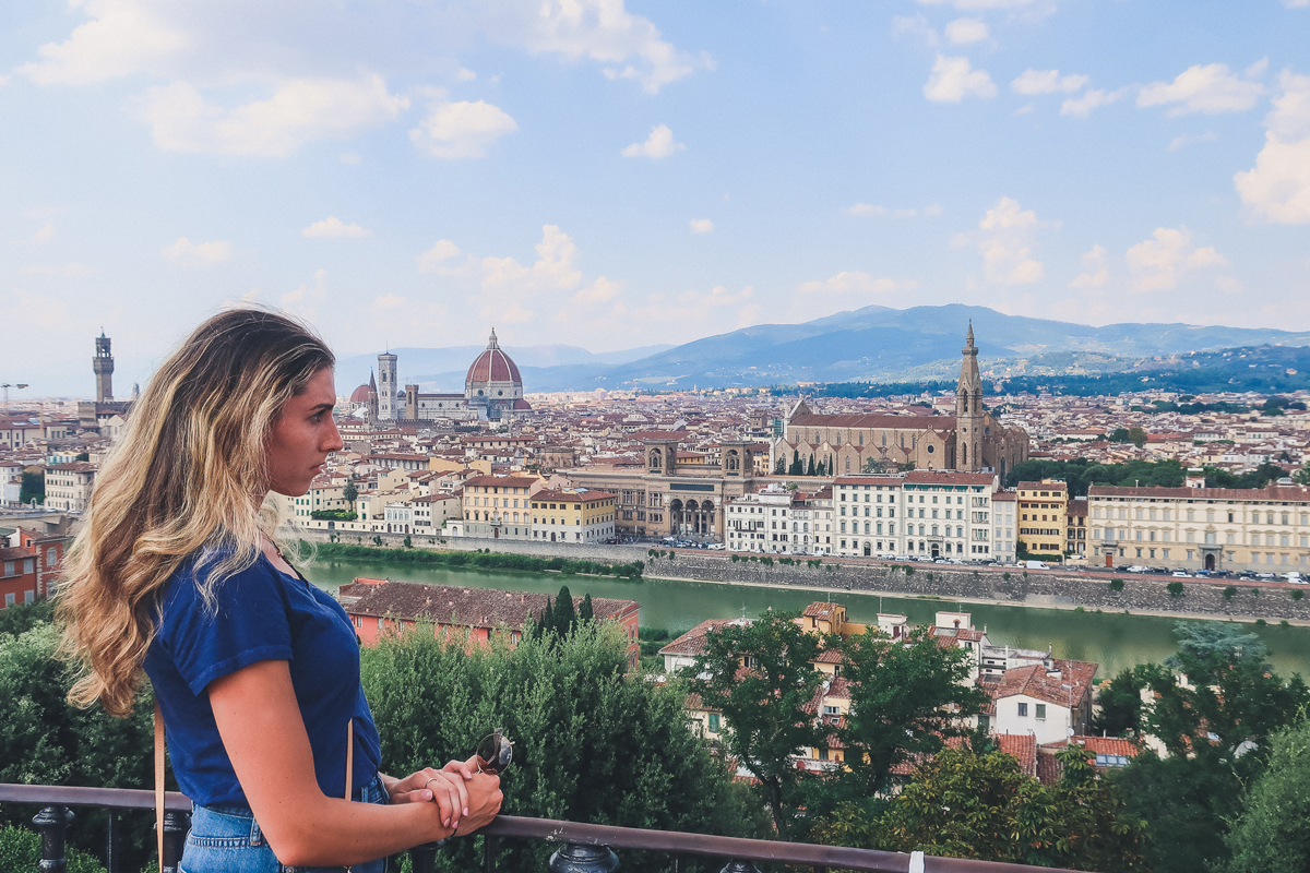 Girl looks out on to Michelangelo Square in Florence