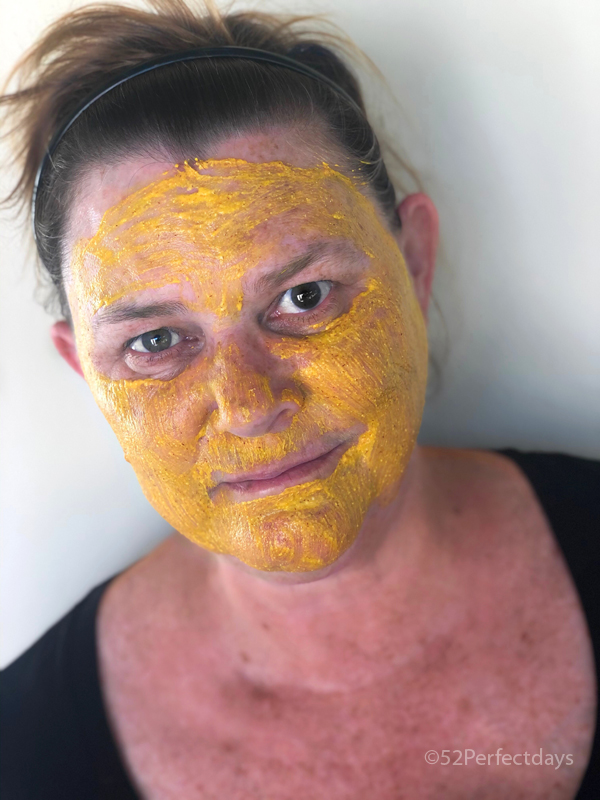 applying the turmeric face mask