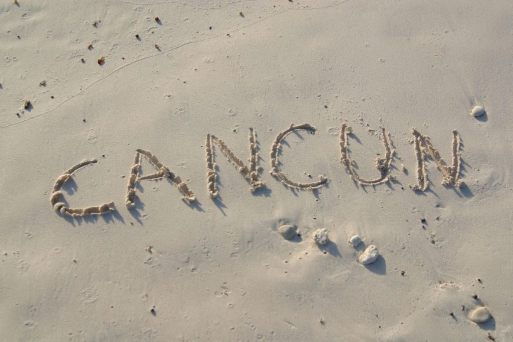 Cancun spelled in sand