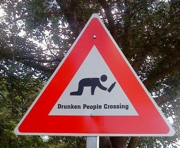 drunken people crossing road sign